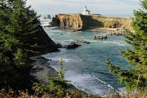 ... and hopped fences to capture the perfect photo of a lighthouse in Coos Bay, Oregon.