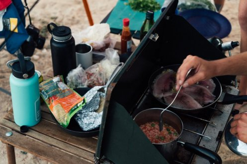 They often cooked vegetarian meals in a cast iron skillet on the van's two-burner stove.